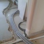 A központi porszívó és a padlófűtés csövei